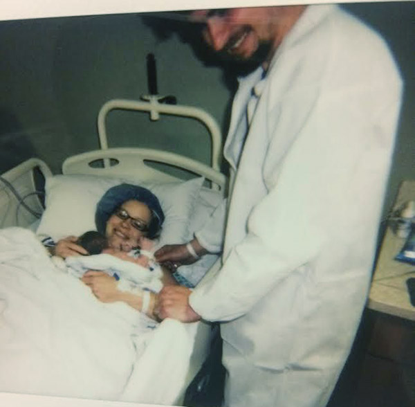 Image of The Photo took by Emily's friend, Alex Mikus right after Calvin was born.
