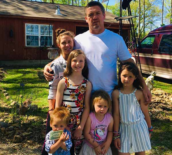Image of Caption: Tricia Day with husband and her four kids