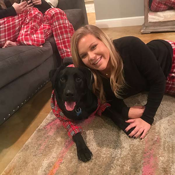 Image of Mallory Gulley with her pet dog, Chet